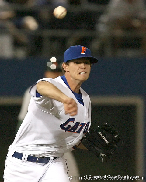 photo by Tim Casey<br /> <br /> Florida freshman pitcher Will Jolin throws out Jason Hagerty at first base after a sacrifice bunt during the eighth inning of the Gators' 8-5 loss to the Miami Hurricanes on Friday, February 27, 2009 at McKethan Stadium in Gainesville, Fla.