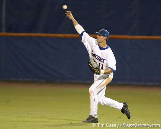 photo by Tim Casey<br /> <br /> Florida sophomore outfielder Riley Cooper returns the ball to the infield after a single during the sixth inning of the Gators' 8-5 loss to the Miami Hurricanes on Friday, February 27, 2009 at McKethan Stadium in Gainesville, Fla.