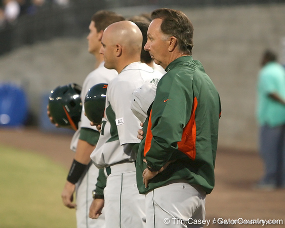 photo by Tim Casey<br /> <br /> Miami coach Jim Morris listens to the national anthem before the Gators' 8-5 loss to the Miami Hurricanes on Friday, February 27, 2009 at McKethan Stadium in Gainesville, Fla.