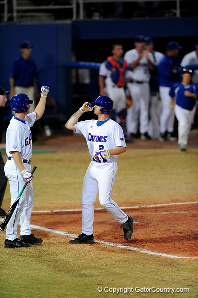 Sophomore infielder Josh Adams gives him teammate a high-five after scoring during the Gators' 8-5 loss to the Miami Hurricanes at McKethan Stadium / Gator Country photo by Casey Brooke Lawson