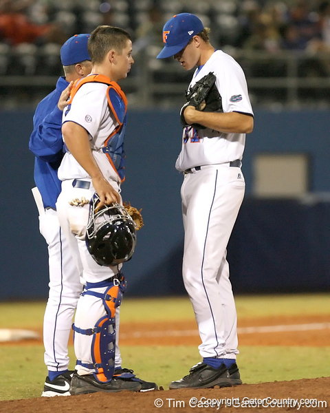 photo by Tim Casey<br /> <br /> Florida head coach Kevin O'Sullivan talks with Buddy Munroe and Will Jolin during the eighth inning of the Gators' 8-5 loss to the Miami Hurricanes on Friday, February 27, 2009 at McKethan Stadium in Gainesville, Fla.