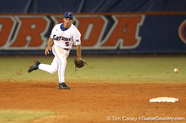 photo by Tim Casey<br /> <br /> Florida junior shortstop Mike Mooney misplays a ground ball during the sixth inning of the Gators' 8-5 loss to the Miami Hurricanes on Friday, February 27, 2009 at McKethan Stadium in Gainesville, Fla.