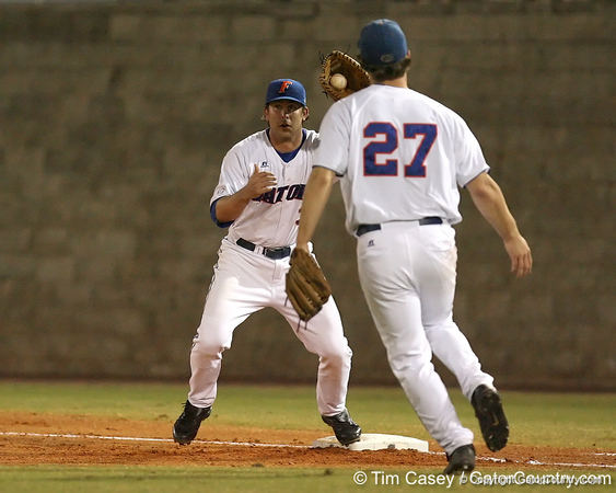 photo by Tim Casey<br /> <br /> Florida senior first baseman Brandon McArthur catches a throw from Patrick Keating on a sacrifice bunt during the second inning of the Gators' 8-5 loss to the Miami Hurricanes on Friday, February 27, 2009 at McKethan Stadium in Gainesville, Fla.