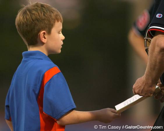 photo by Tim Casey<br /> <br /> A child presents the lineup card to the umpire during the Gators' 8-5 loss to the Miami Hurricanes on Friday, February 27, 2009 at McKethan Stadium in Gainesville, Fla.