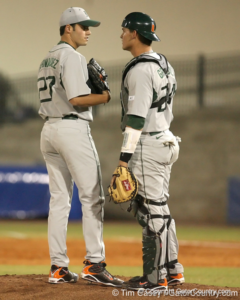 photo by Tim Casey<br /> <br /> Chris Hernandez talks with Yasmani Grandal during the third inning of the Gators' 8-5 loss to the Miami Hurricanes on Friday, February 27, 2009 at McKethan Stadium in Gainesville, Fla.