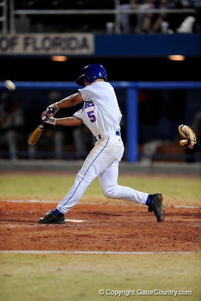 Junior infielder Mike Mooney hits the ball during the Gators' 8-5 loss to the Miami Hurricanes at McKethan Stadium / Gator Country photo by Casey Brooke Lawson