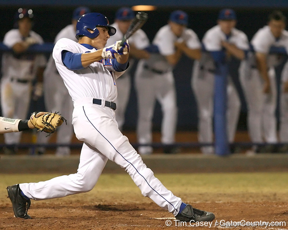 photo by Tim Casey<br /> <br /> Florida freshman outfielder Tyler Thompson hits a single to right field during the eighth inning of the Gators' 8-5 loss to the Miami Hurricanes on Friday, February 27, 2009 at McKethan Stadium in Gainesville, Fla.