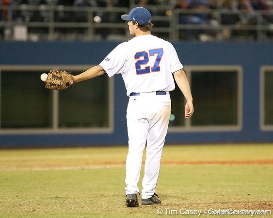 photo by Tim Casey<br /> <br /> Florida senior pitcher Patrick Keating gets a new ball after allowing a home run during the sixth inning of the Gators' 8-5 loss to the Miami Hurricanes on Friday, February 27, 2009 at McKethan Stadium in Gainesville, Fla.