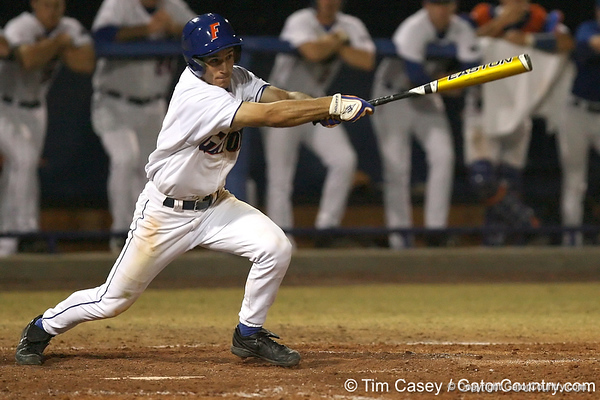 photo by Tim Casey<br /> <br /> Florida junior shortstop Mike Mooney grounds out to second base during the seventh inning of the Gators' 8-5 loss to the Miami Hurricanes on Friday, February 27, 2009 at McKethan Stadium in Gainesville, Fla.
