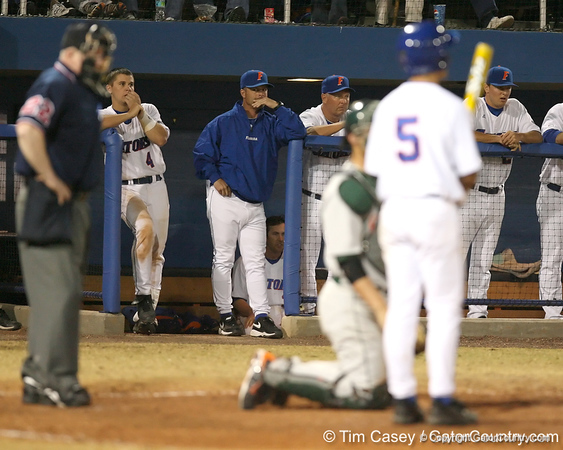 photo by Tim Casey<br /> <br /> Florida baseball head coach Kevin O'Sullivan watches as Mike Mooney bats during the eighth inning of the Gators' 8-5 loss to the Miami Hurricanes on Friday, February 27, 2009 at McKethan Stadium in Gainesville, Fla.