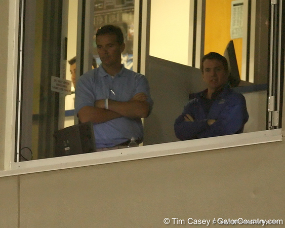 photo by Tim Casey<br /> <br /> Florida head football coach Urban Meyer watches from the press box during the second inning of the Gators' 8-5 loss to the Miami Hurricanes on Friday, February 27, 2009 at McKethan Stadium in Gainesville, Fla.