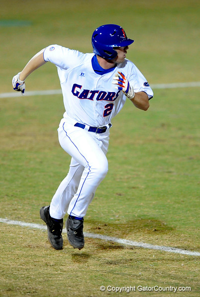 UF sophomore infielder Josh Adams runs toward first base during the Gators' 8-5 loss to the Miami Hurricanes at McKethan Stadium / Gator Country photo by Casey Brooke Lawson