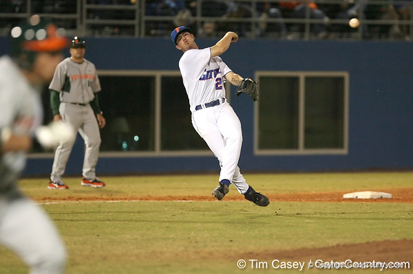 photo by Tim Casey<br /> <br /> Florida sophomore Josh Adams throws out Scott Lawson during the sixth inning of the Gators' 8-5 loss to the Miami Hurricanes on Friday, February 27, 2009 at McKethan Stadium in Gainesville, Fla.