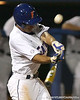 photo by Tim Casey<br /> <br /> Florida junior shortstop Mike Mooney fouls off a pitch during the seventh inning of the Gators' 8-5 loss to the Miami Hurricanes on Friday, February 27, 2009 at McKethan Stadium in Gainesville, Fla.
