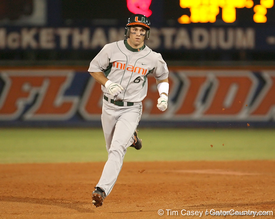 photo by Tim Casey<br /> <br /> Jonathan Weislow rounds the bases after hitting a two-run home run  during the fourth inning of the Gators' 8-5 loss to the Miami Hurricanes on Friday, February 27, 2009 at McKethan Stadium in Gainesville, Fla.
