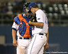photo by Tim Casey<br /> <br /> Florida junior catcher Buddy Munroe talks with Will Jolin during the eighth inning of the Gators' 8-5 loss to the Miami Hurricanes on Friday, February 27, 2009 at McKethan Stadium in Gainesville, Fla.