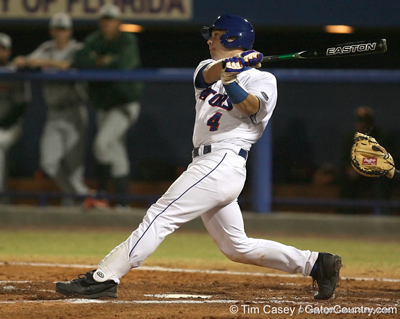 photo by Tim Casey<br /> <br /> Florida junior catcher Buddy Munroe lines out to second base during the second inning of the Gators' 8-5 loss to the Miami Hurricanes on Friday, February 27, 2009 at McKethan Stadium in Gainesville, Fla.