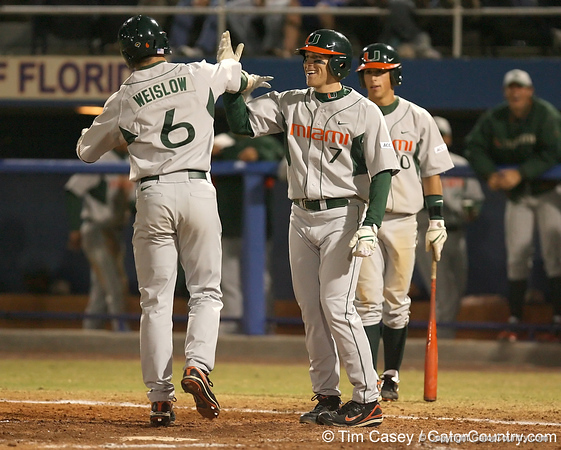 photo by Tim Casey<br /> <br /> Jonathan Weislow crosses the plate after hitting a two-run home run  during the fourth inning of the Gators' 8-5 loss to the Miami Hurricanes on Friday, February 27, 2009 at McKethan Stadium in Gainesville, Fla.