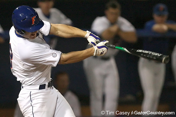 photo by Tim Casey<br /> <br /> Florida freshman outfielder Daniel Pigott hits an RBI single to left center field during the eighth inning of the Gators' 8-5 loss to the Miami Hurricanes on Friday, February 27, 2009 at McKethan Stadium in Gainesville, Fla.
