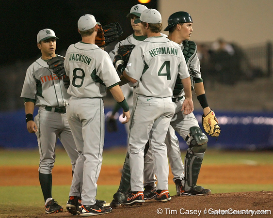 photo by Tim Casey<br /> <br /> Miami pitcher Chris Hernandez talks with teammates during the first inning of the Gators' 8-5 loss to the Hurricanes on Friday, February 27, 2009 at McKethan Stadium in Gainesville, Fla.