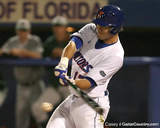 photo by Tim Casey<br /> <br /> Florida junior Matt den Dekker hits a sacrifice fly to center field for an RBI during the third inning of the Gators' 8-5 loss to the Miami Hurricanes on Friday, February 27, 2009 at McKethan Stadium in Gainesville, Fla.