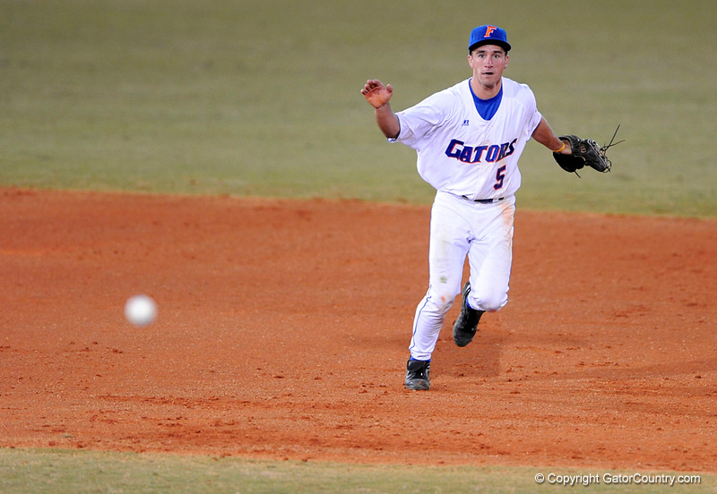 Junior infielder Mike Mooney throws the ball toward a teammate during the Gators' 8-5 loss to the Miami Hurricanes at McKethan Stadium / Gator Country photo by Casey Brooke Lawson
