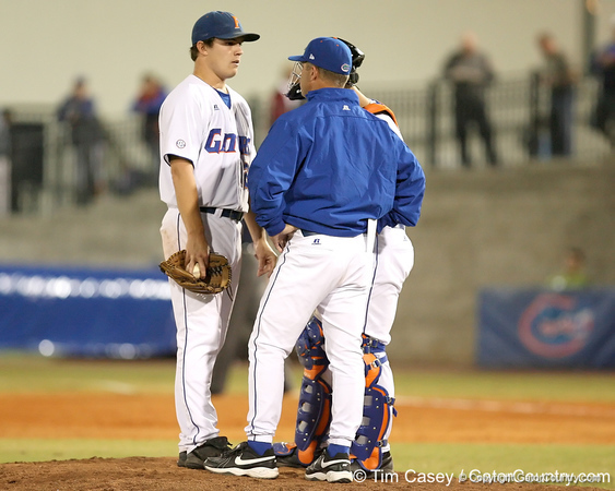 photo by Tim Casey<br /> <br /> Florida senior pitcher Patrick Keating listens to head coach Kevin O'Sullivan during the fourth inning of the Gators' 8-5 loss to the Miami Hurricanes on Friday, February 27, 2009 at McKethan Stadium in Gainesville, Fla.