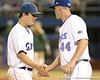 photo by Tim Casey<br /> <br /> Florida senior pitcher Patrick Keating slaps hands with Billy Bullock during the fourth inning of the Gators' 8-5 loss to the Miami Hurricanes on Friday, February 27, 2009 at McKethan Stadium in Gainesville, Fla.