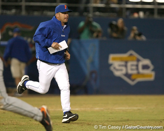 photo by Tim Casey<br /> <br /> Florida baseball head coach Kevin O'Sullivan runs to argue a call with Hank Himmamen after the eighth inning of the Gators' 8-5 loss to the Miami Hurricanes on Friday, February 27, 2009 at McKethan Stadium in Gainesville, Fla.