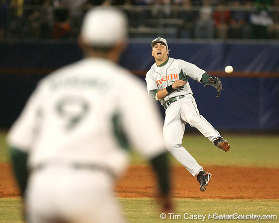 photo by Tim Casey<br /> <br /> Scott Lawson makes a throwing error on a single by Brandon McArthur during the fifth inning of the Gators' 8-5 loss to the Miami Hurricanes on Friday, February 27, 2009 at McKethan Stadium in Gainesville, Fla.