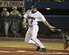 photo by Tim Casey<br /> <br /> Florida sophomore Josh Adams lines out to third base during the first inning of the Gators' 8-5 loss to the Miami Hurricanes on Friday, February 27, 2009 at McKethan Stadium in Gainesville, Fla.