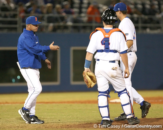 photo by Tim Casey<br /> <br /> Florida head coach Kevin O'Sullivan gets the ball from Will Jolin during the eighth inning of the Gators' 8-5 loss to the Miami Hurricanes on Friday, February 27, 2009 at McKethan Stadium in Gainesville, Fla.