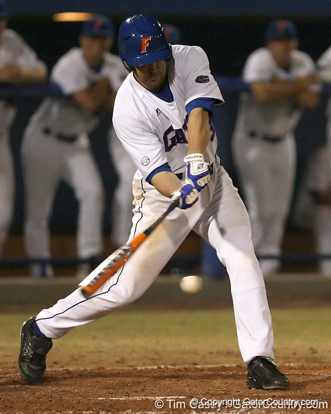 photo by Tim Casey<br /> <br /> Florida senior first baseman Brandon McArthur hits an RBI single to second base during the fifth inning of the Gators' 8-5 loss to the Miami Hurricanes on Friday, February 27, 2009 at McKethan Stadium in Gainesville, Fla.