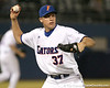 photo by Tim Casey<br /> <br /> Florida freshman pitcher Greg Larson throws out Harold Martinez on a sacrifice bunt during the ninth inning of the Gators' 8-5 loss to the Miami Hurricanes on Friday, February 27, 2009 at McKethan Stadium in Gainesville, Fla.