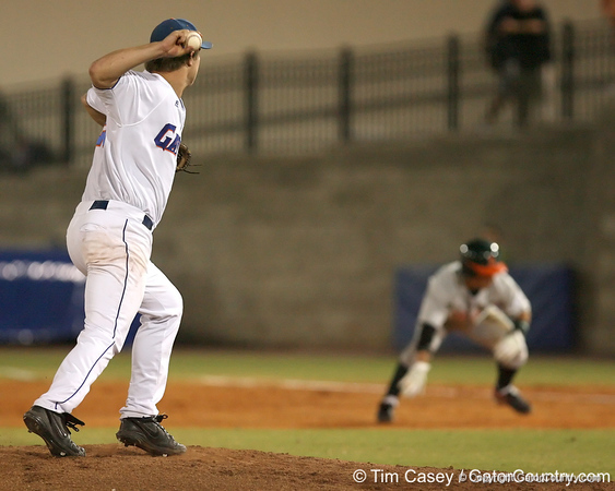 photo by Tim Casey<br /> <br /> Florida senior pitcher Patrick Keating attempts to pick off Nathan Melenres during the third inning of the Gators' 8-5 loss to the Miami Hurricanes on Friday, February 27, 2009 at McKethan Stadium in Gainesville, Fla.