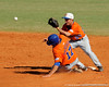 Florida junior Mike Mooney awaits a throw as junior Matt den Dekker slides into second base during the University of Florida Orange and Blue scrimmage game in Gainesville, Fla on November 8, 2008. (Casey Brooke Lawson / Gator Country)