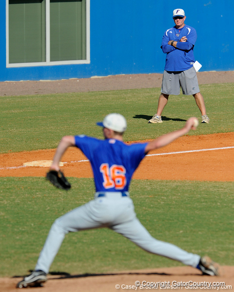 Freshman Anthony DeSclafani pitches while Florida baseball assistant coach Craig Bell watches during the University of Florida Orange and Blue scrimmage game in Gainesville, Fla on November 8, 2008. (Casey Brooke Lawson / Gator Country)