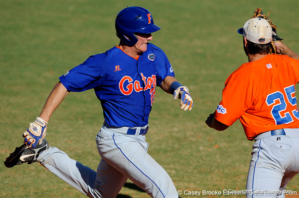 Junior catcher Hampton Tignor touches first base during the University of Florida Orange and Blue scrimmage game in Gainesville, Fla on November 8, 2008. (Casey Brooke Lawson / Gator Country)