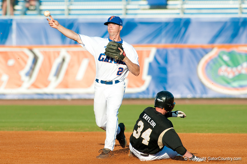 Josh Adams turns a double play in the University of Florida 16-3 win against the University of Central Florida on 4/8/09.         Photo by: Tim Darby
