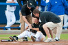 Kyle Mills receives treatment from trainers after being hit by a pitch during the University of Florida 16-3 win against the University of Central Florida on 4/8/09         Photo by: Tim Darby