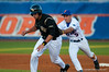 Mike Mooney tags out UCF's Kiko Vazquez  during the University of Florida 16-3 win against the University of Central Florida on 4/8/09         Photo by: Tim Darby