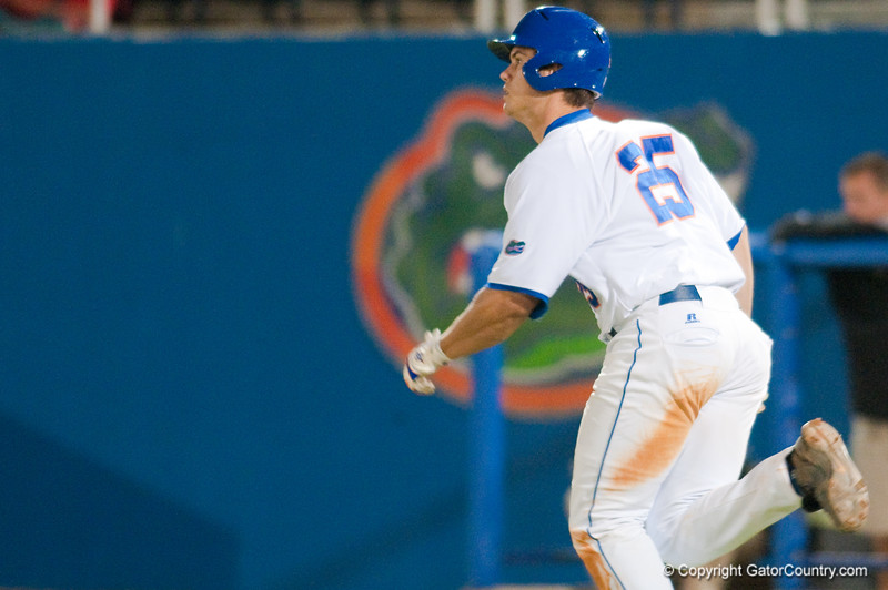 Preston Tucker watches his third home run of the game leave McKethan Stadium during the University of Florida 16-3 win against the University of Central Florida on 4/8/09         Photo by: Tim Darby
