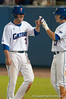 Brandon McArthur is greeted by Matt den Dekker after scoring in the bottom of the sixth inning during the University of Florida 16-3 win against the University of Central Florida on 4/8/09         Photo by: Tim Darby