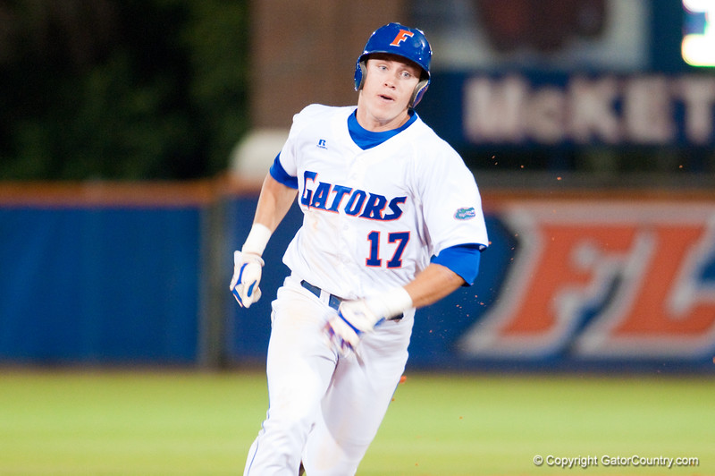 Matt den Dekker runs to third during the University of Florida 16-3 win against the University of Central Florida on 4/8/09         Photo by: Tim Darby