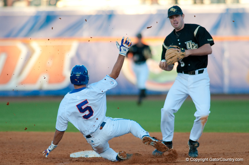 Mike Mooney slides into second and breaks up a double play during the University of Florida 16-3 win against the University of Central Florida on 4/8/09         Photo by: Tim Darby