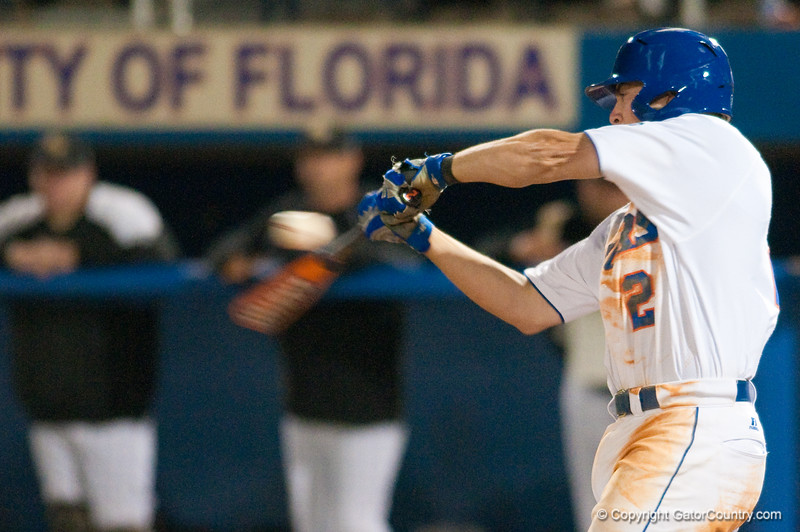 Josh Adams makes contact during the bottom of the seventh inning during the University of Florida 16-3 win against the University of Central Florida on 4/8/09         Photo by: Tim Darby