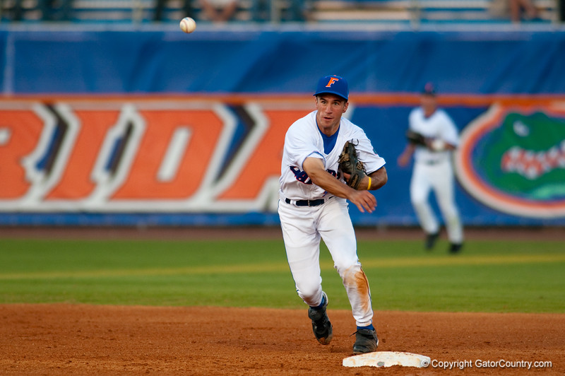 Mike Mooney throws to first during the University of Florida 16-3 win against the University of Central Florida on 4/8/09         Photo by: Tim Darby