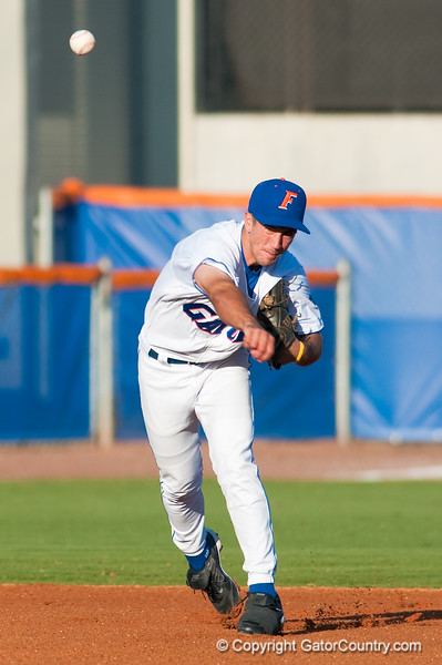 Mike Mooney throws to first in the University of Florida 16-3 win against the University of Central Florida on 4/8/09         Photo by: Tim Darby