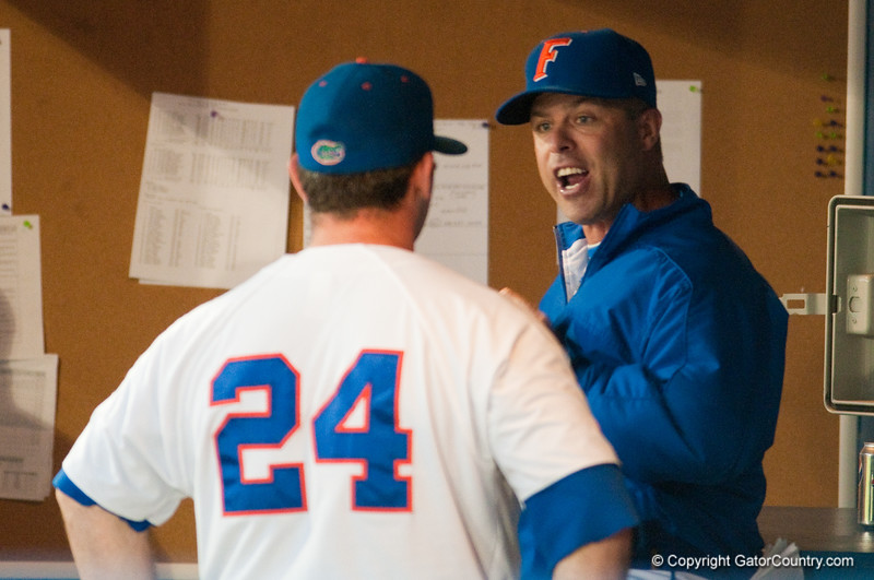 Coach Kevin O'Sullivan has a discussion with Alex Panteliodis in the dugout during the University of Florida 16-3 win against the University of Central Florida on 4/8/09         Photo by: Tim Darby
