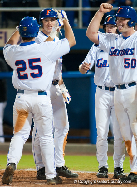 Preston Tucker is congratulated by teammates after hitting his first grand slam of the night during the University of Florida 16-3 win against the University of Central Florida on 4/8/09         Photo by: Tim Darby